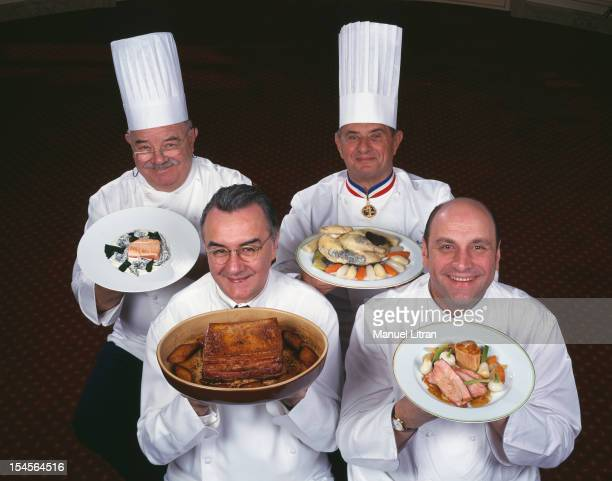 In the studio the four chefs Pierre Troisgros Paul Bocuse Alain Ducasse Bernard Loiseau and in work clothes presenting each dish for the XXIst...