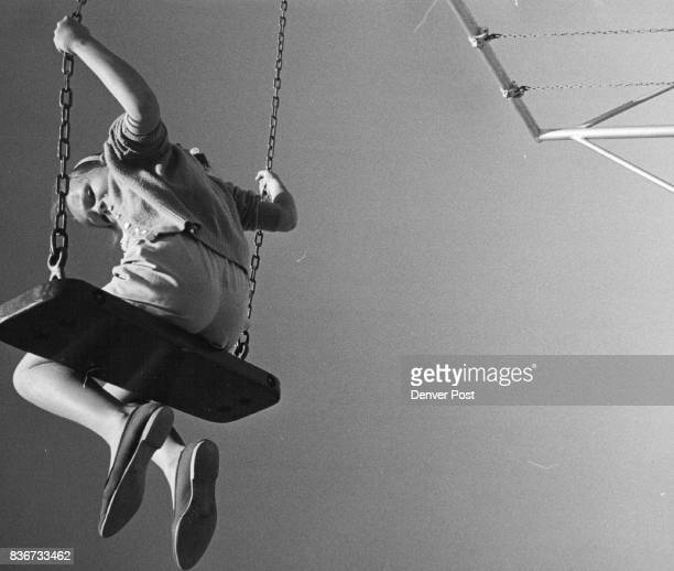 In the Swing of Things Jan Murray of 1764 Elmira St puts a warm spring day to good use by going swinging in Aurora's City Park Credit Denver Post