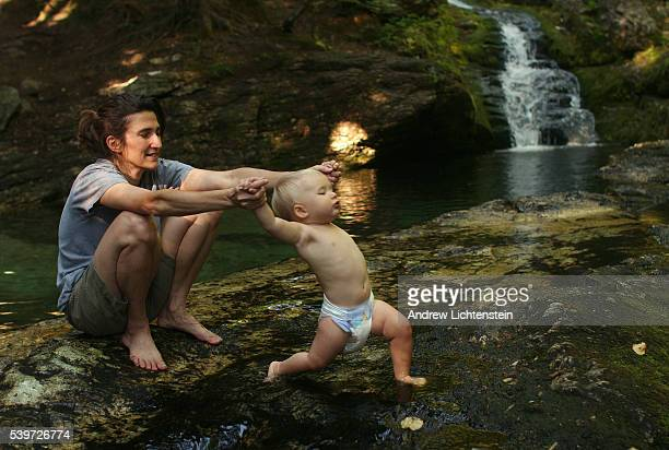 In the White Mountains National Forest Linda Rosier helps her daughter Jade Lichtenstein with her first steps