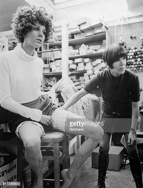In the workroom of one of her shops Mary tries out a new ideafrilly 'gapclosers' to keep winter's chills out of the wide open spaces above a girl's...