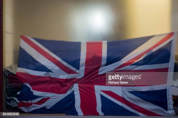 In the year that Britain will start the process of Brexit a crumpled British Union Jack flag in the window of a City retailer on 2nd February 2017 in...
