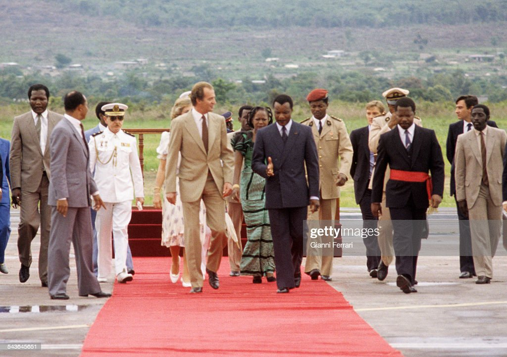 In their official trip to Congo, the Spanish Kings Juan Carlos of borbon and Sofia are received at the airport of Brazaville by President <a gi-track='captionPersonalityLinkClicked' href=/galleries/search?phrase=Denis+Sassou+Nguesso&family=editorial&specificpeople=4126626 ng-click='$event.stopPropagation()'>Denis Sassou Nguesso</a>, 1983, Congo. (Photo by Gianni Ferrari/Cover/Getty Images).