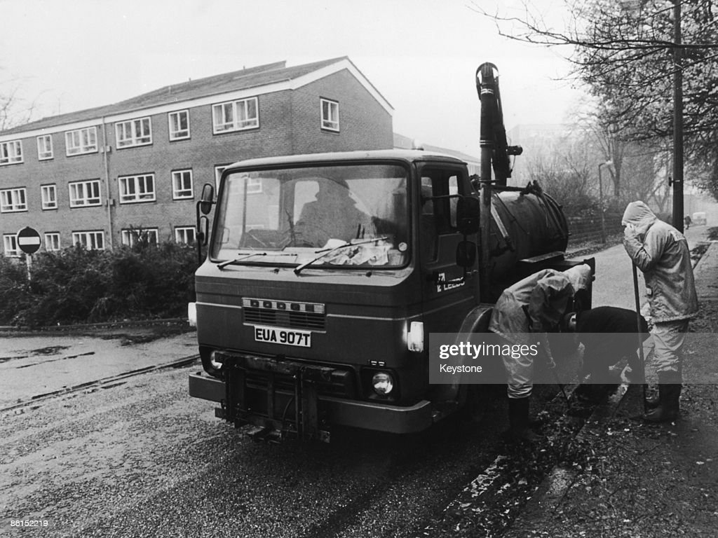 In their search for evidence police clear the drains outside the Leeds home of murder victim Jacqueline Hill 26th November 1980 A 20yearold student...