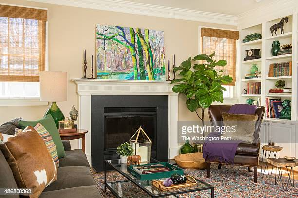 In these scenes from her 'four seasons' of design interior decorator Annie Elliott of Bossy Color has decorated this single living room for Autumn...
