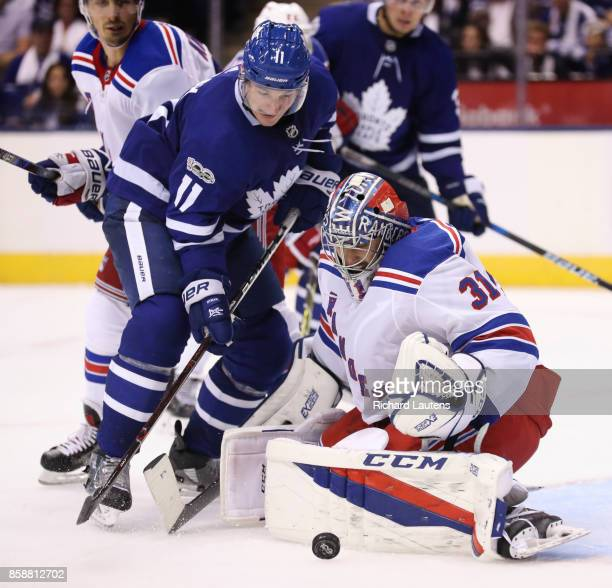 TORONTO ON OCTOBER 7 In third period action Toronto Maple Leafs center Zach Hyman presses hard but can't get around New York Rangers goalie Ondrej...