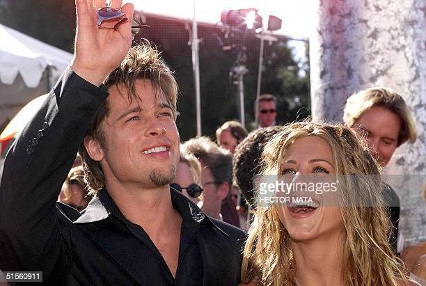 In this 12 September 1999 file photo US actors Brad Pitt and Jennifer Aniston arrive for the 51st Emmy Awards 12 September 1999 in Los Angeles...