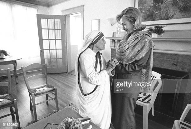 In this 19 June 1995 file photo released by the White House First Lady Hillary Rodham Clinton meets with Mother Teresa at the opening of the Mother...
