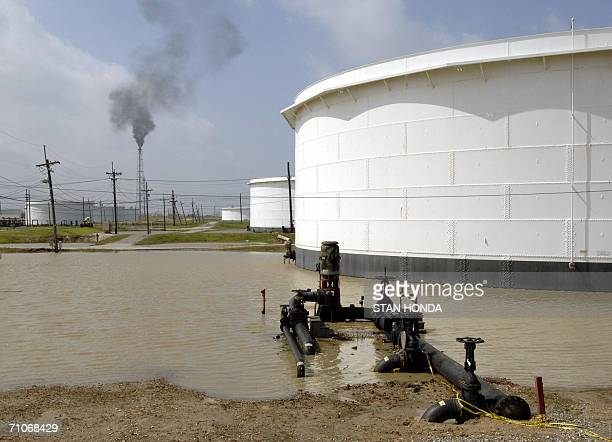 In this 25 September file photo floodwaters surround storage tanks at an idle oil refinery in Port Arthur Texas in the aftermath of Hurricane Rita...