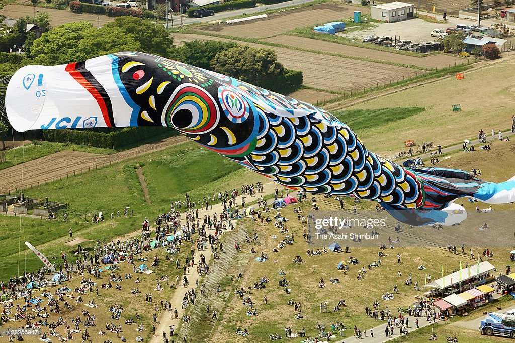 In this aerial image, a 100-meter-long giant carp streamer is hung on May 3, 2014 in Kazo, Saitama, Japan. Kazo city is famous for carp streamers production.