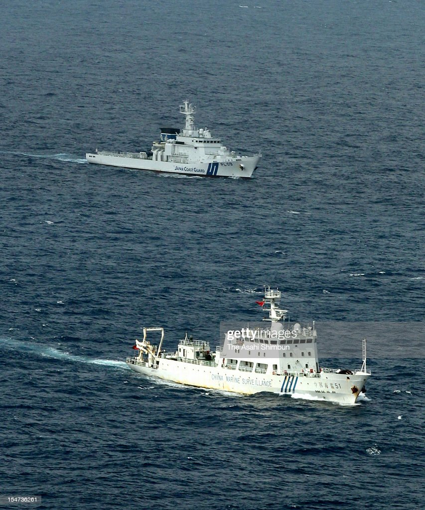 In this aerial image a China Marine Surveillance ship sails along with Japan Coast Guard Patrol ship in the Japanese contiguous zone 27kilometer...
