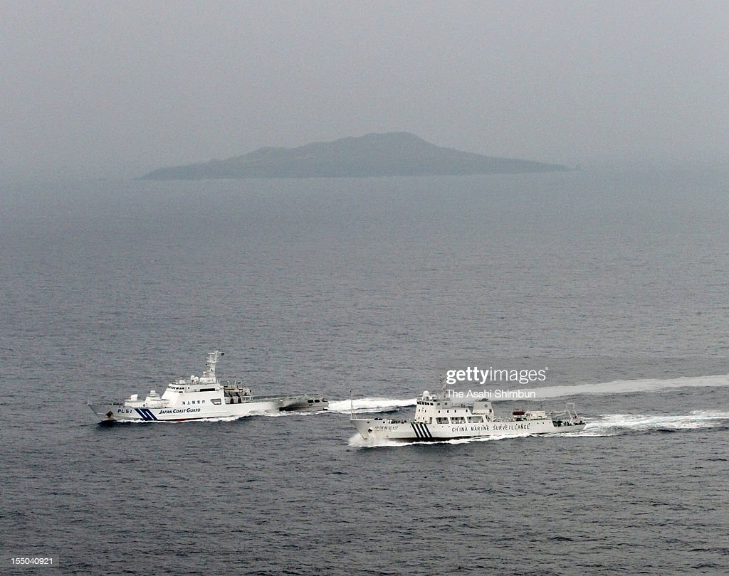 In this aerial image, a China Marine Surveillance ship (R) sails along with Japan Coast Guard Patrol ship at 12-kilometer north from Kubajima Island on October 30, 2012 in Ishigaki, Okinawa, Japan. It is eigth times that Chinese official vessels sails into Japan's territorial sea since Japanese government purchased part of the disputed Senkaku Islands.