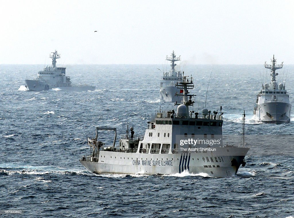In this aerial image, a China Marine Surveillance vessel (front) cruises with Japan Coast Guard ships near the disputed Senkaku Islands on April 23, 2013 in Ishigaki, Okinawa, Japan. 8 Chinese ships intruded into Japan's territorial water for up to 12 hours.