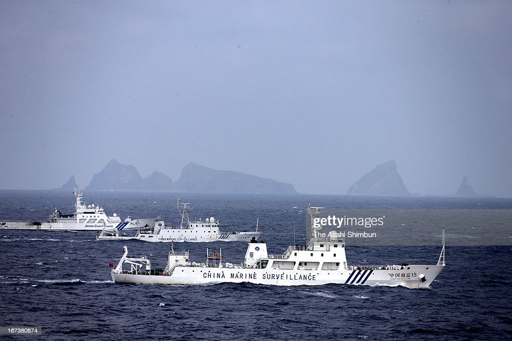 In this aerial image a China Marine Surveillance vessels cruises with a Japan Coast Guard ship near Kita kojima and Minami kojima of the disputed...