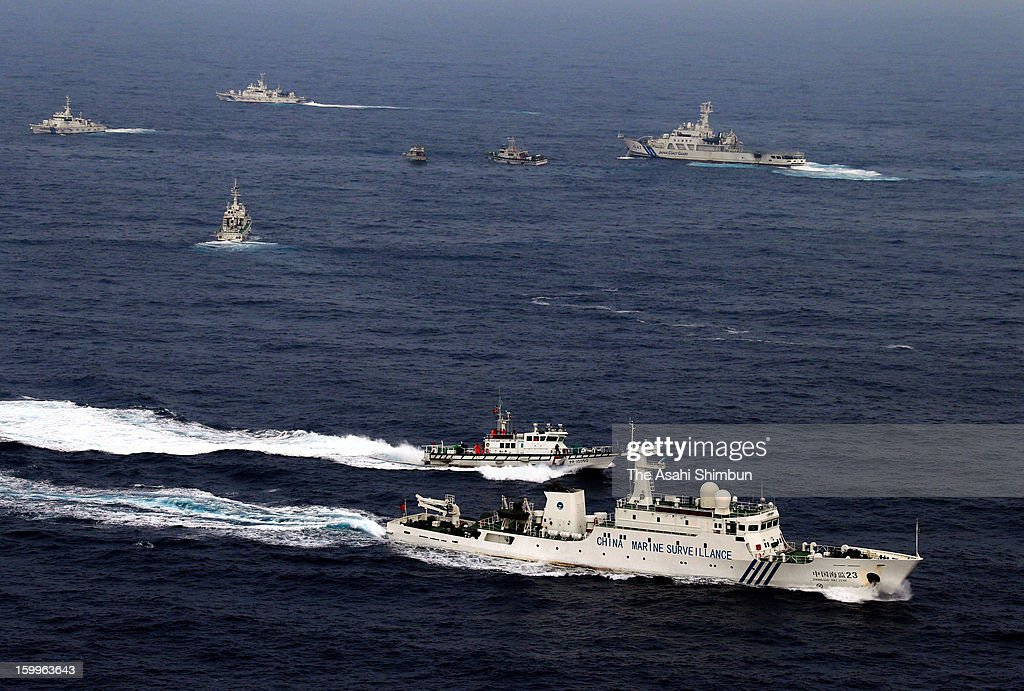 In this aerial image, a Chinese Surveillance ship (bottom) sails at the contiguous zone of Senkaku Islands while Japan Coast Guard (JCG) patrol ships and Taiwanese boats and coast guard vessels converge at some 33 kilometers west-southwest from Uotsuri Island on January 24, 2013 in Ishigaki, Okinawa, Japan. The boat, protected by four Taiwanese coast guard vessels, enters the contiguous zone of disputed islands known as Senkaku Islands in Japan and Diaoyu Islands in China, Tiaoyutai in Taiwan.