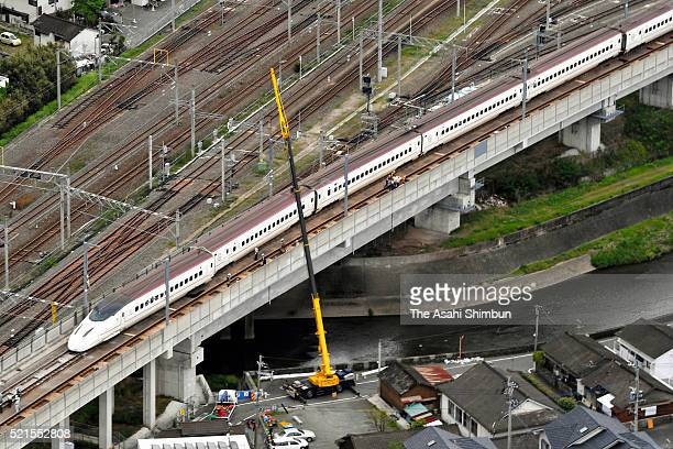 In this aerial image a crane operates to restore the derailed Kyushu Shinkansen bullet train on April 16 2016 in Kumamoto Japan The magnitude 73...