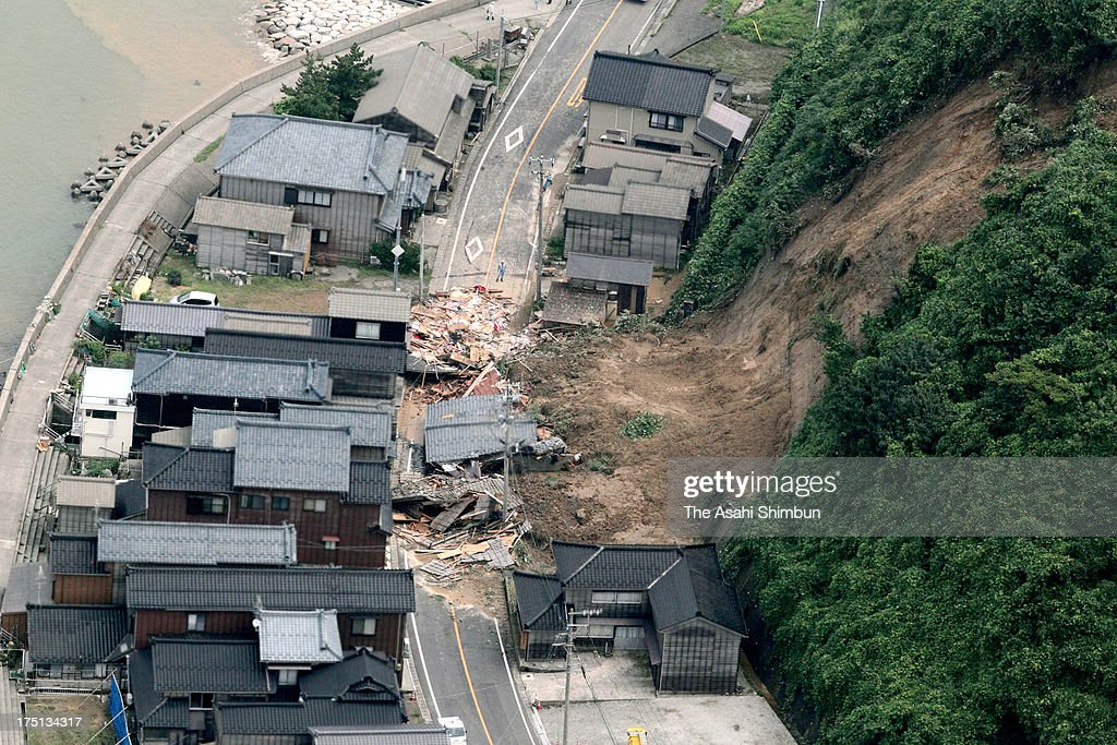 In this aerial image, a destroyed house by landslide is seen on August 1, 2013 in Nagaoka, Niigata, Japan. Torrential rain continue in many parts of Japan, a man is confirmed dead, after rescued from a squashed house.