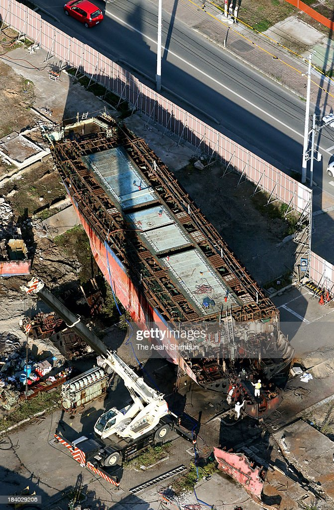 In this aerial image, a dismantlement work of the Dai 18 Kyotoku Maru continues on October 10, 2013 in Kesennuma, Miyagi, Japan. The 330-ton fishing boat washed away 750 meters inland by the towering tsunami after the magnitude 9.0 earthquake in 2011.