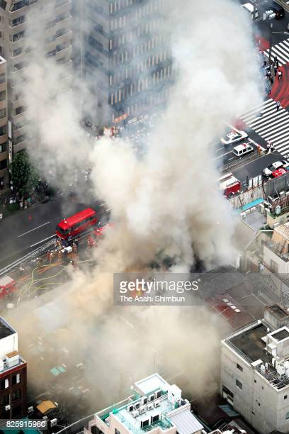 In this aerial image a fire destroyed several buildings outside Tokyo's famed Tsukiji fish market on August 3 2017 in Tokyo Japan The blaze in the...