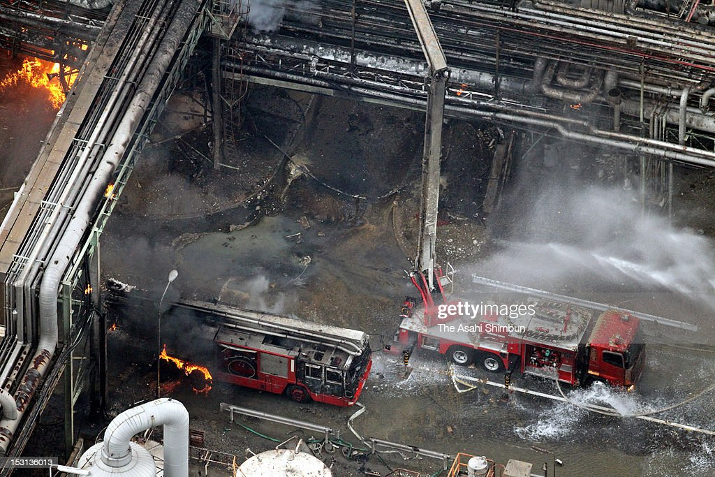 In this aerial image, a fire truck (L) is in the blaze at Nippon Shokubai Himeji factory on September 29, 2012 in Himeji, Hyogo, Japan. A firefighter was killed by being involved in the second explosion.