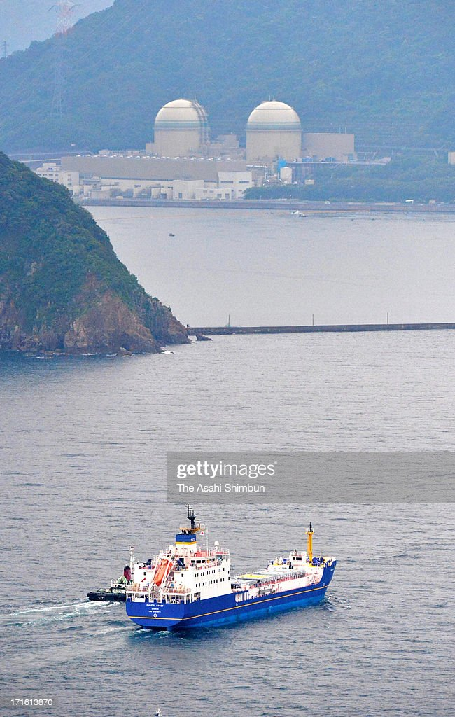 In this aerial image, a freighter carrying mixed oxide (MOX) fuel runs towards Kansai Electric Power Co Takahama Nuclear Power Plant, escorted by 10 or so coast guard and police vessels on June 27, 2013 in Takahama, Fukui, Japan. Protesters oppose outside the plant as this is the first shipment of MOX fuel since the meltdowns at the Fukushima No. 1 power plant arrived in Japan, which plutonium stockpile is already equivalent to 5,000 Nagasaki-type atomic bombs.