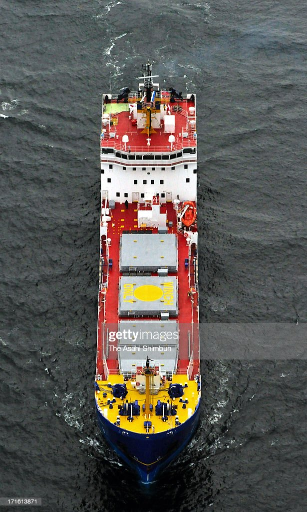 In this aerial image, a freighter carrying mixed oxide (MOX) fuel runs towards Kansai Electric Power Co Takahama Nuclear Power Plant on June 27, 2013 in Takahama, Fukui, Japan. Protesters oppose outside the plant as this is the first shipment of MOX fuel since the meltdowns at the Fukushima No. 1 power plant arrived in Japan, which plutonium stockpile is already equivalent to 5,000 Nagasaki-type atomic bombs.