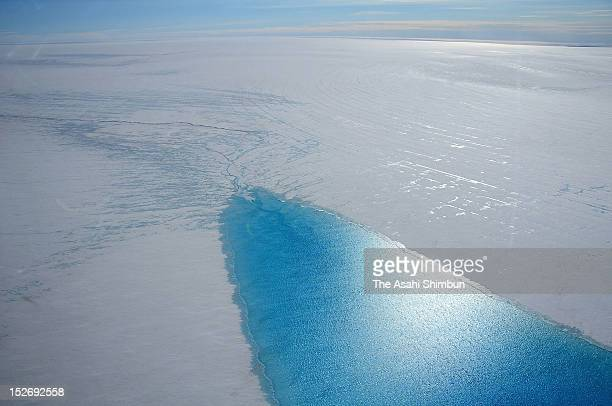 In this aerial image a lake made by melting glacier is seen on July 30 2012 near Qaanaaq Greenland In Greenland there is said to be approximately ten...