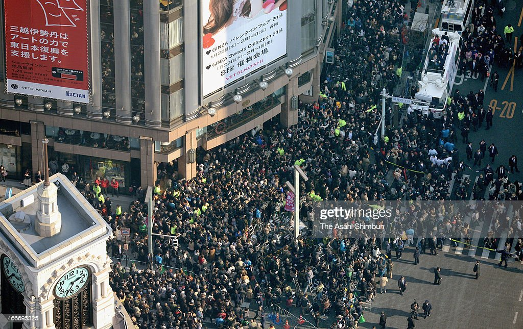 In this aerial image, a large crowd hears a candidate's campaign speech for the Tokyo gubernatorial election in the Ginza shopping district on February 2, 2014 in Tokyo, Japan.