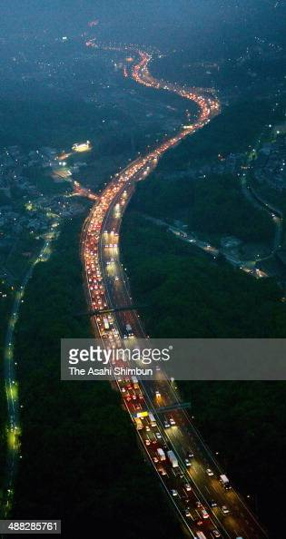In this aerial image a long queue of rear lamps of holiday goer cars are seen toward Osaka at Chugoku Expressway on May 5 2014 in Nishinomiya Hyogo...