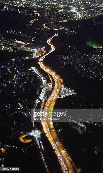 In this aerial image a long queue of rear lamps of holiday goer cars are seen at Chugoku Expressway on September 22 2015 in Nishinomiya Hyogo Japan