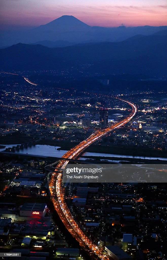 In this aerial image, a long traffic jam on the Tokyo-bound lanes of the Tomei Expressway, 34-kilometre-long according to the Japan Road Traffic Information Center, is seen on August 17, 2013 in Ebina, Kanagawa, Japan. People spent their 'bon' holiday return to Tokyo and its metropolitan area over the weekend.