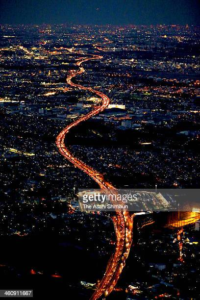 In this aerial image a long traffic jam on the Tokyobound lanes of the Tomei Expressway is seen on January 4 2014 in Ebina Kanagawa Japan People...