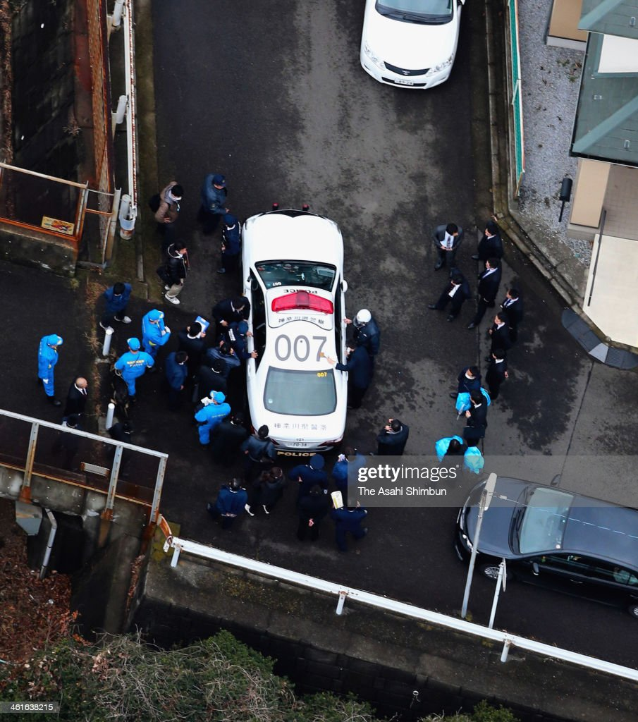 In this aerial image, a police car with a rape suspect on the run is seen on January 9, 2014 in Yokohama, Japan. A rape suspect who had escaped from a district prosecutors' office during an interview with his lawyer was re-arrested ending three days of man's run and total of 10,000 officers' chase.