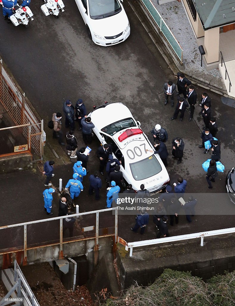 In this aerial image, a police car with a rape suspect who was on the run is seen on January 9, 2014 in Yokohama, Japan. A man on suspicion of robbing andgang-raping who had escaped from a district prosecutors' office during an interview with his lawyer was re-arrested ending three days of man's run and total of 10,000 officers' chase.