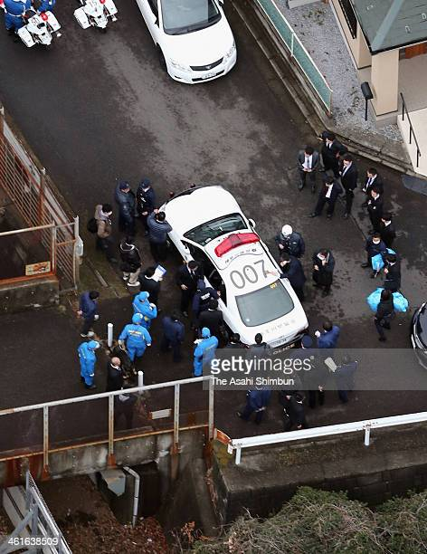 In this aerial image a police car with a rape suspect who was on the run is seen on January 9 2014 in Yokohama Japan A man on suspicion of robbing...