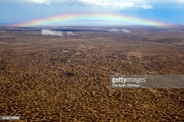 In this aerial image a rainbow is seen over polygons on permaforest on June 20 2017 in Alaska United States In April 2017 US President Donald Trump...