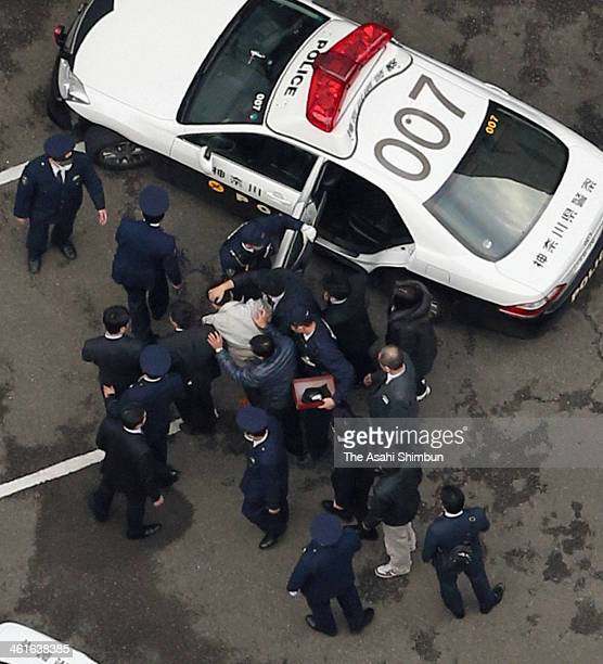 In this aerial image a rape suspect arrives at the Kawasaki prosecuter's office on January 9 2014 in Kawasaki Japan A man on suspicion of robbing and...