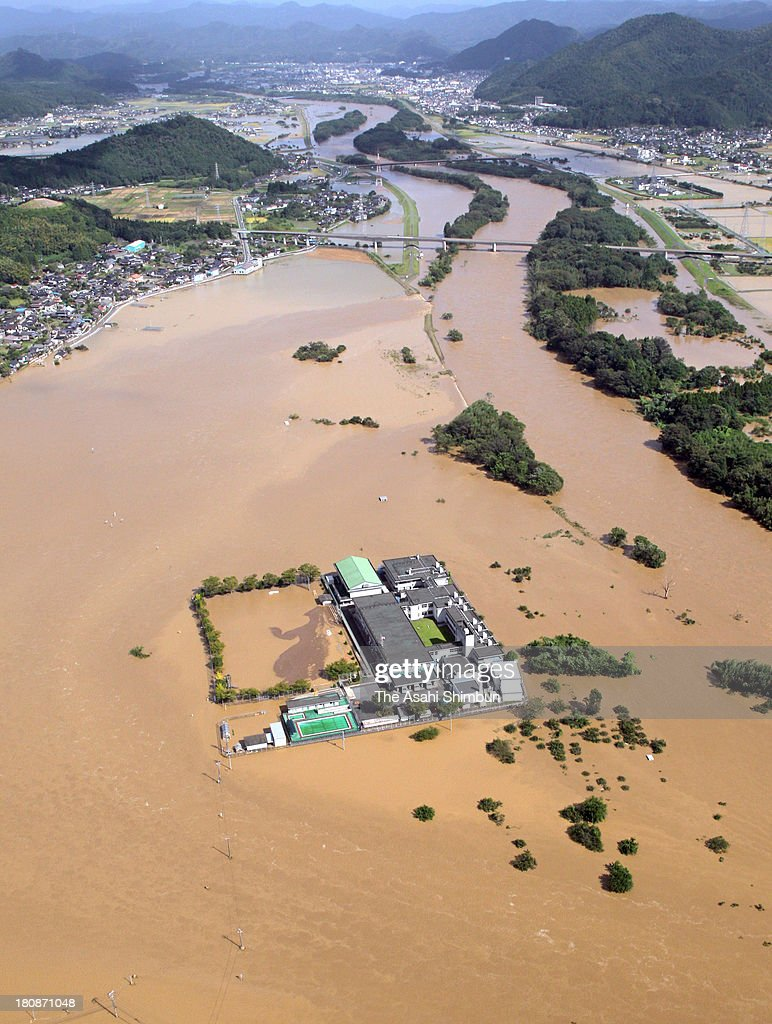 In this aerial image, a school is isolated due to the flood of Yura River triggered by typhoon Man-Yi approaching on September 16, 2013 in Fukuchiyama, Kyoto, Japan. The storm hit land near Toyohashi, Aichi Prefecture, before 8 a.m. and moved along Honshu throughout the day, damaging buildings, disrupting transportation and causing blackouts, three killed and five missing.