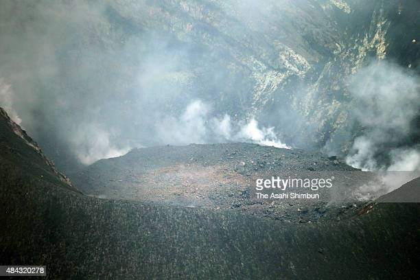 In this aerial image A volcanic plume rises from the Showa vent of Mount Sakurajima are seen on August 15 2015 in Kagoshima Japan Residents of parts...