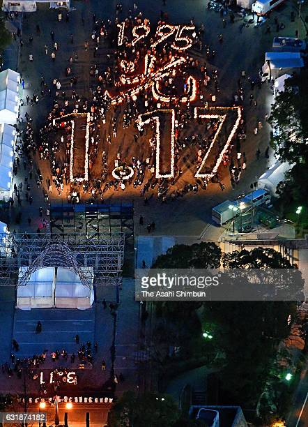 In this aerial image about 7000 bamboo lanterns forming giant numbers shimmered at a memorial service to remember the victims of the massive...