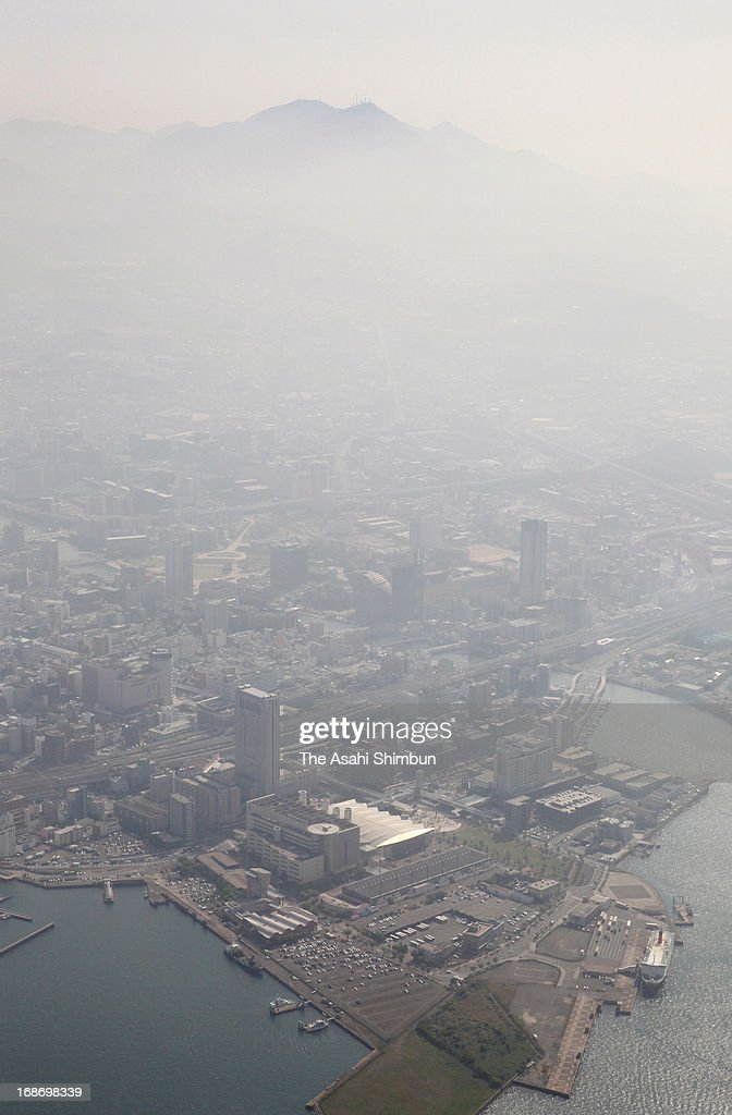 In this aerial image, air pollution due to fine particulate matter PM2.5 forming a thick fog above Kitakyushu on May 13, 2013 in Kitakyushu, Fukuoka, Japan. The city headquarters issued the warning.