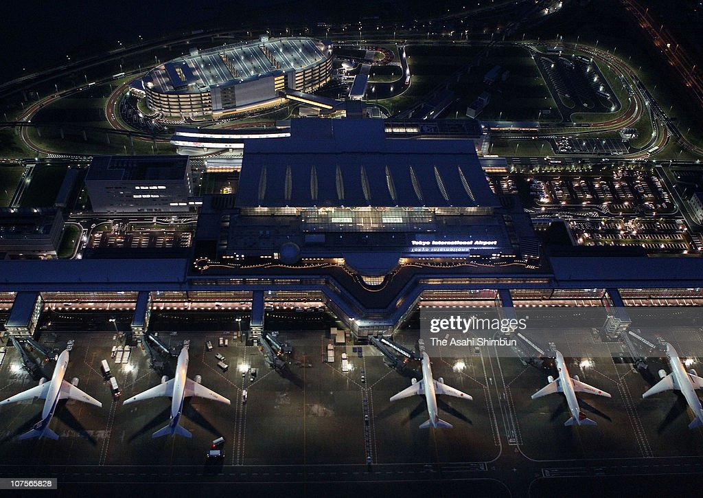 In this aerial image, airplanes sit at the newly opened International terminal of Tokyo International (Haneda) Airport on October 21, 2010 in Tokyo, Japan.