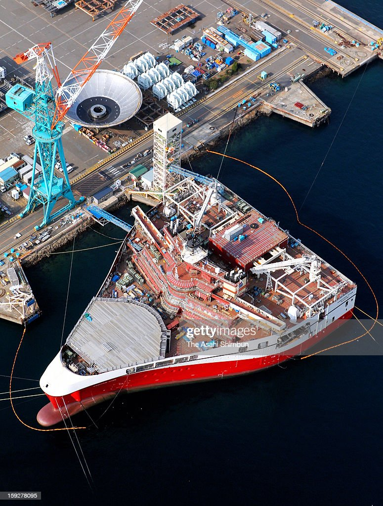 In this aerial image, an aquanautics vessel is under construction at Mitsubishi Heavy Industry Nagasaki Shipyard on January 9, 2013 in Nagasaki, Japan. The 100-meter-long 70-meter-wide underwater resource research ship, equipped 24 cables at aft peak to catch the sonic waves reflecting from the seabed, will be delivered to a Norwegian underwater survey company.