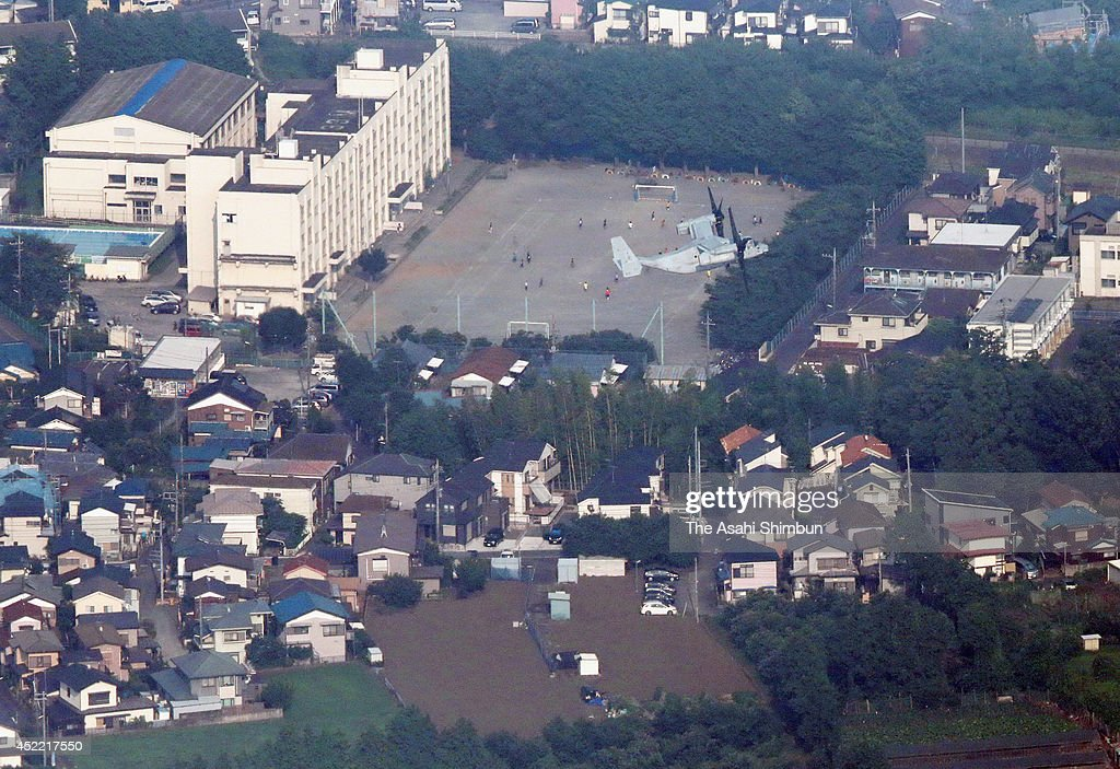 In this aerial image, an Osprey aircraft heads to Shizuoka Prefecture from Atsugi base on July 14, 2014 in Yamato, Kanagawa, Japan. MV-22 Osprey aircraft deployed to the U.S. Marine Corps Air Station Futenma in Ginowan, Okinawa Prefecture, in 2012 arrived at Camp Fuji in Shizuoka Prefecture following a refueling stop at Atsugi base in Kanagawa Prefecture. Defense Minister Itsunori Onodera put the rest of Japan on notice by announcing that flight training involving controversial U.S. military Osprey aircraft will become commonplace across the nation.
