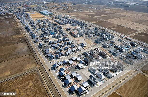 In this aerial image brand new houses are seen on February 21 2015 in Iwanuma Miyagi Japan This is the first large scale collective relocation since...