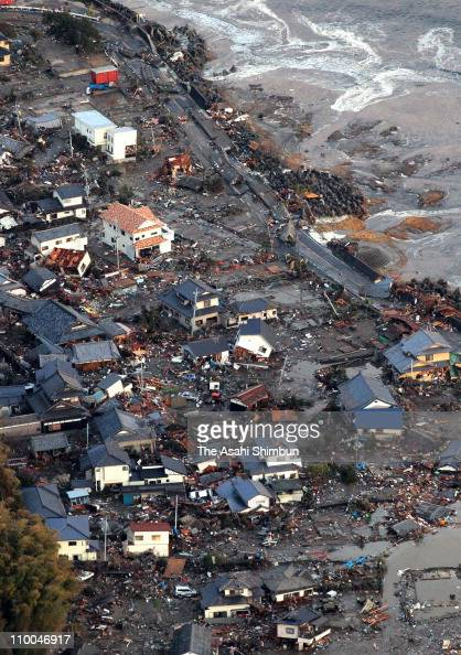 In this aerial image damaged Iwaki City is seen after a 90 magnitude strong earthquake struck off the coast of northeastern Japan March 14 2011 in...