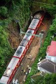In this aerial image derailed carriages of the Keikyu Line are seen at mudslide site on September 25 2012 in Yokosuka Kanagawa Japan Keikyu Line...