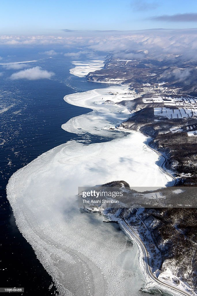 In this aerial image, drift ice is seen arriving at a coast of Shiretoko Peninsula on January 17, 2013 in Shari, Hokkaido, Japan. Drift ice in Sea of Okhotsk is known as one of Hokkaido's winter attraction.