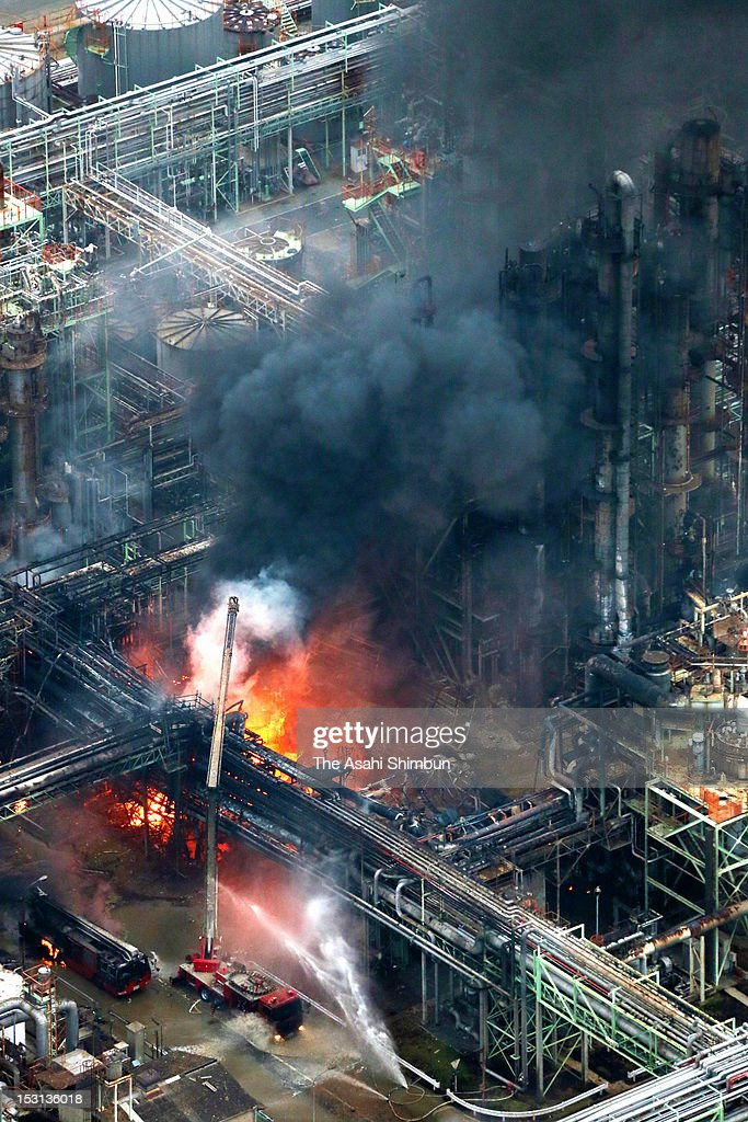 In this aerial image, firefighters battle with the blaze at Nippon Shokubai Himeji factory on September 29, 2012 in Himeji, Hyogo, Japan. A firefighter was killed by being involved in the second explosion.