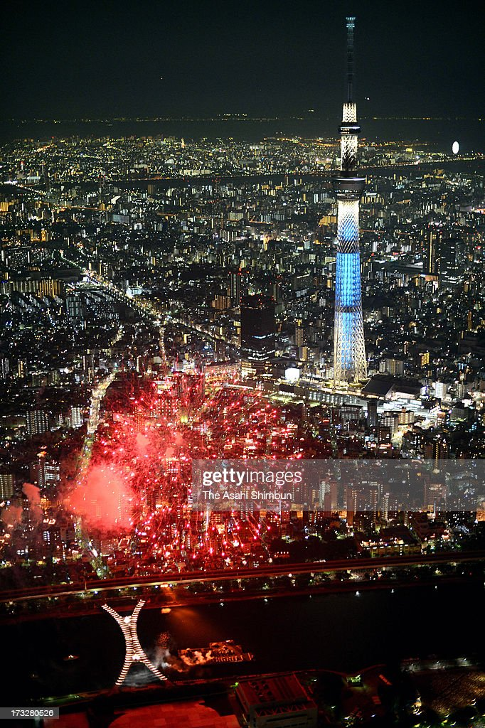 In this aerial image, fireworks explode around Tokyo Skytree during Sumida River Fireworks Festival on July 28, 2012 in Tokyo, Japan.
