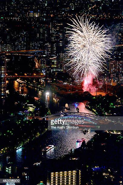 In this aerial image fireworks explode during the Tenjin Festival along the Okawa River on July 25 2015 in Osaka Japan The Tenjin Festival one of the...